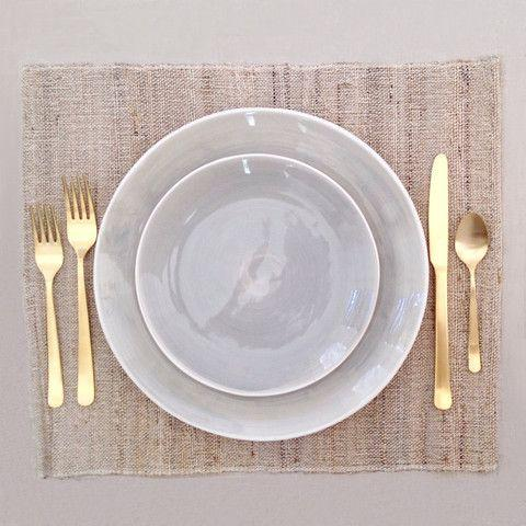 white plate with gold flatware