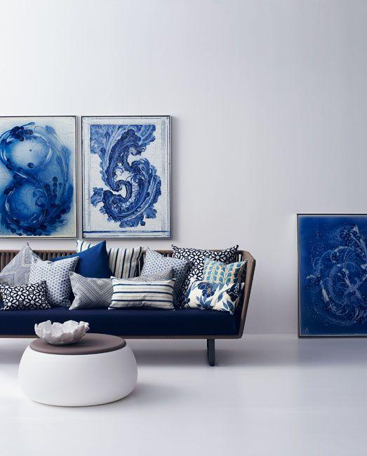 ikat pillows on blue sofa