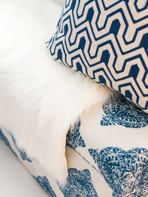blue ikat pillows and flokati