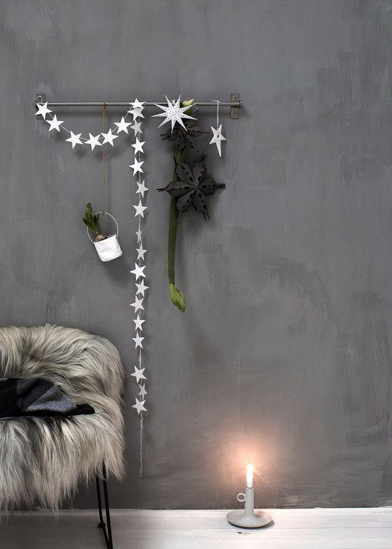 star garland on gray wall