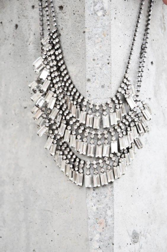 rhinestone necklace on concrete